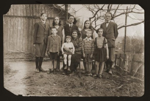 <p>Family portrait of the Gartenberg family in Drohobycz, Poland. None of those pictured would survive the Holocaust. Photograph taken in 1930.</p> <p>Top row: Julius Gartenberg, Anna Fern, Bernard Klinger, Ona Fern and Izador Gartenberg. Lower row: Marcus Gartenberg, Hinda Gartenberg with her grandaughter Tony Schwartz on her lap, Sol Schwartz, and Ida Fern.</p>