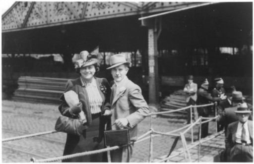 A Jewish refugee couple poses on the gangway of the St Louis as they disembark from the ship in Antwerp after it was force to return from Cuba.