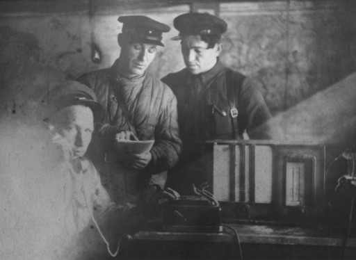 Vasiliy Nikitich Semyonov, chief of staff of the Shish detachment of the Molotov partisan brigade, makes a telephone call from a partisan bunker. Photograph taken by Faye Schulman.