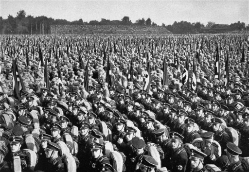 Members of the SA and SS stand in formation during Reichsparteitag (Reich Party Day) ceremonies in Nuremberg, Germany, 1933.