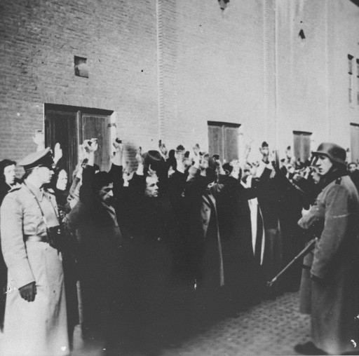 "<p>German police round up Jews in the Jewish quarter of <a href=""/narrative/5543/en"">Amsterdam</a>, blockaded following anti-Nazi violence. Amsterdam, the Netherlands, February 22, 1941.</p>"