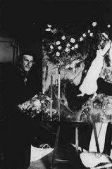 "<p><a href=""/narrative/11584/en"">Marc Chagall</a>, the Russian Jewish artist, at work in his studio in southern France. Gords, France, 1940.</p>"