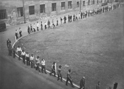 Prisoners march in the courtyard of the Gestapo headquarters in Nuremberg.