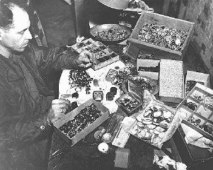 <p>The valuables displayed here were confiscated from prisoners by German guards at the Buchenwald concentration camp and later found by soldiers of the Third US Army after the liberation of the camp. Buchenwald, Germany, after April 1945.</p>