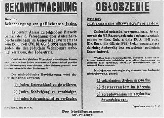 <p>A Nazi decree issued in October 1941, in German and Polish, warns that Jews leaving the ghetto, or Poles who aid them, will be executed. Czestochowa, Poland.</p>