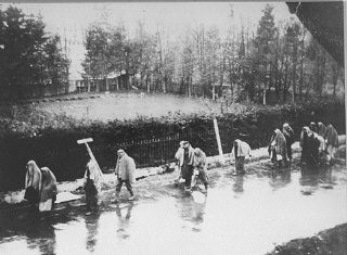 """<p>A view of the <a href=""""/narrative/11271/en"""">death march</a> from <a href=""""/narrative/4391/en"""">Dachau</a> passing through villages in the direction of Wolfratshausen. German civilians secretly photographed several death marches from the Dachau concentration camp as the prisoners moved slowly through the Bavarian towns of Gruenwald, Wolfratshausen, and Herbertshausen. Few civilians gave aid to the prisoners on the death marches. Germany, April 1945.</p>"""