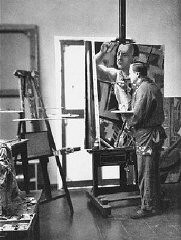 <p>Georg Grosz, a Communist satirical artist and painter, seen here in his studio in Berlin. He fled Germany shortly before the Nazi rise to power in 1933 and was one of the first to be stripped of his German citizenship by the Nazis. Berlin, Germany, 1929.</p>