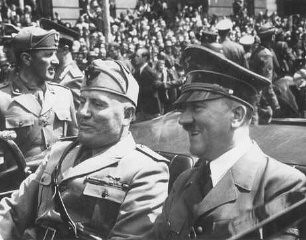 "<p><a href=""/narrative/3343/en"">Axis</a> leaders Adolf Hitler and Italian prime minister Benito Mussolini meet in Munich, Germany, 1940.</p>"