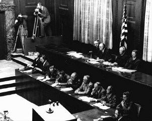 "<p>American judges (top row, seated) during the <a href=""/narrative/9245/en"">Doctors Trial</a>, case #1 of the Subsequent Nuremberg Proceedings. Presiding Judge Walter B. Beals is seated second from the left. Nuremberg, Germany, December 9, 1946–August 20, 1947.</p>"