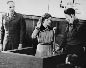 <p>Fifteen-year-old Maria Dolezalova is sworn in as a prosecution witness at the RuSHA Trial. Dolezalova was among the children kidnapped by German forces after they destroyed the town of Lidice, Czechoslovakia. Nuremberg, October 30, 1947.</p>