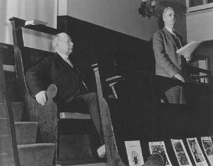 "<p>Rufus Jones (seated) and Clarence Pickett were chairman and executive secretary of the <a href=""/narrative/4339/en"">American Friends Service Committee</a> (AFSC), respectively. They are pictured here at a Quaker meeting in Philadelphia. The AFSC assisted Jewish and Christian European refugees. Philadelphia, United States, January 22, 1943.</p>"