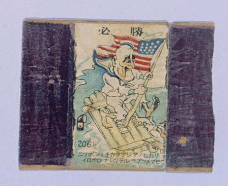 "<p>During the war the Japanese flooded Shanghai with anti-American and anti-British propaganda, including this image from a matchbox cover. It depicts United States President Franklin D. Roosevelt--dressed in rags, on a raft in the ocean, and holding onto the U.S. flag--in the view of a Japanese submarine periscope. Shanghai, China, between 1943 and 1945. [From the USHMM special exhibition <a href=""/narrative/10592/en"">Flight and Rescue</a>.]</p>"