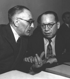Professor Raphael Lemkin, left, and Ricardo Alfaro of Panama (chairman of the Assembly's Legal Committee) in conversation before the plenary meeting of the General Assembly at which the Convention on the Prevention and Punishment of Genocide was approved.