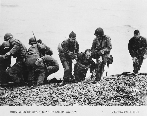 """<p>US troops pull the survivors of a sunken craft on to the shores of the Normandy beaches on <a href=""""/narrative/2899/en"""">D-Day</a>. Normandy, France, June 6, 1944.</p>"""