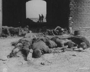 """<p>Burned bodies of former prisoners of Rottleberode, a subcamp of <a href=""""/narrative/4909/en"""">Dora-Mittelbau</a>, lie near the entrance to a barn that had been set on fire by SS troops while the prisoners were on a <a href=""""/narrative/2931/en"""">death march</a>. Gardelegen, Germany, April 18, 1945.</p>"""