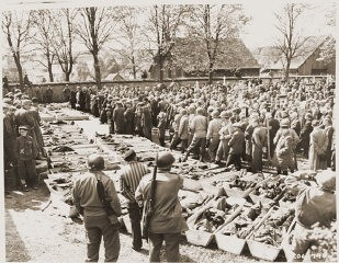 """<p>US troops and German civilians from Neunburg vorm Wald attend a funeral service for Polish, Hungarian, and Russian Jews found in the forest near their town. The victims were shot by the SS while on a death march from Flossenbürg. Neunburg, Germany, April 29, 1945.</p> <p><span style=""""font-weight: 400;"""">Following the discovery of death march victims, US Army officers forced local Germans to view the scene of the crime and ordered the townspeople to give the victims a proper burial. </span></p>"""