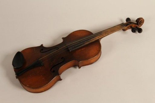 <p>Violin owned by Rita Prigmore and originally used by her father, who played with his four brothers in a band in Germany before World War II. Rita and her family were members of the Sinti group of Roma (Gypsies). She and her twin sister Rolanda were born in 1943. Rolanda died as a result of medical experiments on twins in the clinic where they were born. Rita and her mother survived the war and moved to the United States, before returning to Germany to run a Sinti human rights organization that sought to raise consciousness about the fate of Roma during the Holocaust.</p>