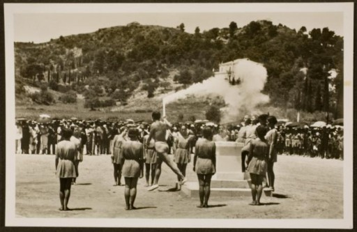 """<div class=""""datapair"""">A runner begins the torch relay (the first """"Olympia Fackel-Staffel-Lauf"""") in Oympia, Greece., ca. July 1936. <p>The <a href=""""/narrative/7139/en"""">1936 Games</a> were the first to employ the torch run. Each of 3,422 torch bearers ran one kilometer (0.6 miles) along the route of the torch relay from the site of the ancient Olympics in Olympia, Greece, to Berlin. Former German Olympian Carl Diem modeled the relay after one that had been run in Athens in 80 B.C. It perfectly suited Nazi propagandists, who used torchlit parades and rallies to attract Germans, especially <a href=""""/narrative/11357/en"""">youth</a>, to the Nazi movement.</p> </div> <div class=""""datapair""""></div>"""
