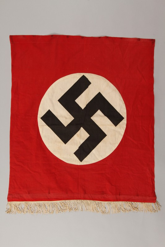 "<p>Nazi banner with a swastika. The swastika became the most recognizable icon of Nazi <a href=""/narrative/81/en"">propaganda</a>, appearing on the Nazi flag, election posters, arm bands, medallions, and badges for military and other organizations.</p>"