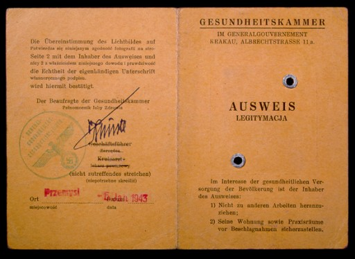 """<p>In July 1942, the German health department located in Krakow (Krakau), occupied Poland, issued this identity card to Max Diamant. This view shows the front and back covers of the card. The interior pages identify Diamant as a dental assistant in Przemysl, Poland, and show his signature and photograph mounted under the stamped word """"Jew.""""</p>"""