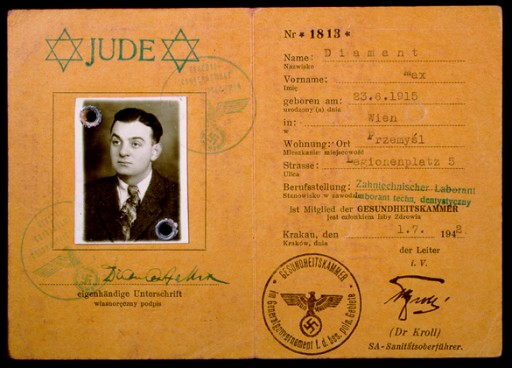 <p>Max Diamant obtained this identity card from the German health department located in Krakow (Krakau), occupied Poland, in July 1942. This view shows the interior pages, which identify him as a Jew and detail his personal information, such as occupation (dental assistant), birthdate (June 23, 1915), birthplace (Vienna), and current address in Przemysl, Poland.</p>