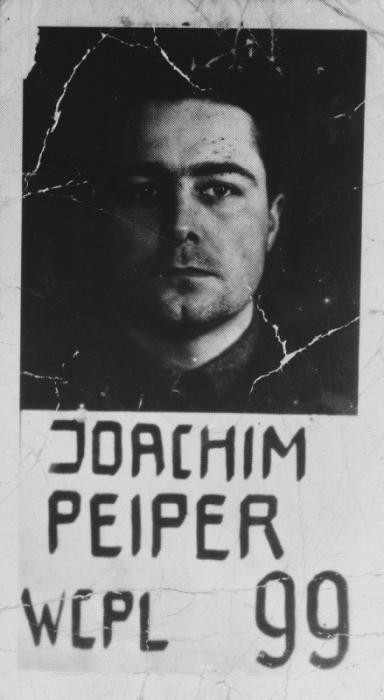 """<p>Mugshot of Colonel Joachim Peiper, defendant in the <a href=""""/narrative/24610/en"""">Malmedy atrocity</a> trial. He was sentenced to death by hanging. Photograph taken ca. 1946.</p>"""