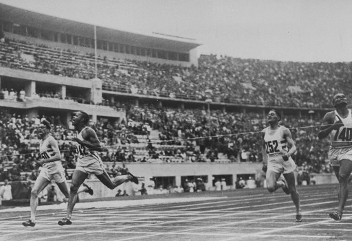 American runner Archie Williams (2nd from left) breaks the tape at the finish line of the 400m event at the Olympic games in Berlin. Williams won the race in a record time of 46.5 seconds.