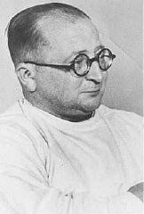 <p>Nazi physician Carl Clauberg, who performed medical experiments on prisoners in Block 10 of the Auschwitz camp. Place and date uncertain.</p>