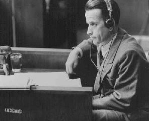 "<p>Waldemar Hoven, head SS doctor at the <a href=""/narrative/3956/en"">Buchenwald</a> concentration camp, testifies in his own defense at the <a href=""/narrative/9245/en"">Doctors Trial</a>. Hoven conducted medical experiments on prisoners. Nuremberg, Germany, June 23, 1947.</p>"