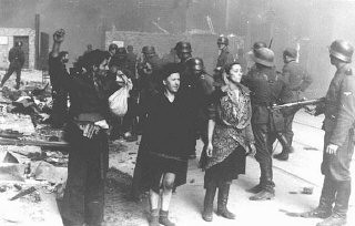 <p>Jewish resistance fighters captured by SS troops during the Warsaw ghetto uprising. Warsaw, Poland, April 19-May 16, 1943.</p>