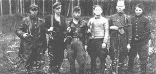 "<p>A group of Jewish <a href=""/narrative/5679/en"">partisans</a> in the Rudniki forest, near <a href=""/narrative/3169/en"">Vilna</a>, between 1942 and 1944.</p>"