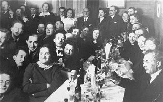 """<p>Family and friends are gathered for a Jewish wedding celebration in Kovno.Among those pictured are Jona and Gita Wisgardisky (standing at the back on the right).</p> <p>In the summer of 1941 soon after the German occupation of <a href=""""/narrative/5762/en"""">Lithuania</a>, the Wisgardisky family was forced into the Kovno <a href=""""/narrative/286/en"""">ghetto</a>. During a roundup of children in the gehtto in 1942, Henia (Gita and Jona's daughter)was hidden in a secret room that her father built in a pantry in their apartment. Later she was smuggled out of the ghetto and placed with the Stankiewicz family. Jonas Stankiewicz had worked as the foreman in Jona Wisgardisky's chemical plant before the war, and had taken it over after the occupation.</p> <p>After successfully securing a hiding place for their daughter, the Wisgardiskys fled from the ghetto. They found refuge on a potato farm, where they lived in a root cellar.</p> <p>Photograph taken in<a href=""""/narrative/3182/en"""">Kovno</a>, Lithuania, ca. 1938.</p>"""