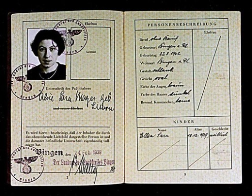 """<p>A German passport issued to Alice Mayer on February 24, 1939, in Bingen, Germany. Mayer's daughter, Ellen, is also listed on the passport. Both mother and daughter's names include the middle name """"Sara."""" This middle name became a mandatory addition required by a law of August 17, 1938. Thereafter, all Jewish women in Germany with a first name of """"non-Jewish"""" origin had to add """"Sara"""" as a middle name on all official documents. Jewish men had to add the name """"Israel"""". This enabled German officials to identify them as Jewish.</p>"""
