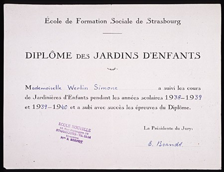<p>Simone Weil used this forged diploma and other false papers to document a new identity assumed in late 1943. As Simone Werlin, she could avoid arrest and change residence to facilitate her rescue of Jewish children as a member of the relief and rescue organization Oeuvre de Secours aux Enfants (Children's Aid Society; OSE). Weil had earned the diploma, which certified her to teach kindergarten in France, from the School of Social Work in Strasbourg in 1940. The director of the school willingly forged this new version.</p>