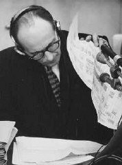 "<p>During his trial, <a href=""/narrative/3359/en"">defendant Adolf Eichmann</a> reads a chart outlining the administrative hierarchy of the German <a href=""/narrative/10735/en"">Third Reich</a>. Jerusalem, Israel. June 27 1961.</p>"