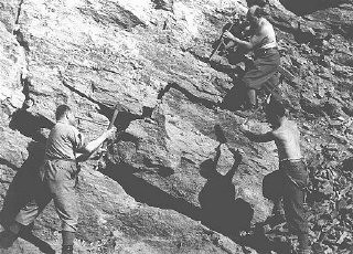 """<p>Jewish forced laborers in the quarry of a forced-labor camp established by the Hungarian government. Tokaj, <a href=""""/narrative/6206/en"""">Hungary</a>, 1940.</p>"""