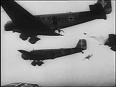 <p>Germany launched its western offensive on May 10, 1940. German paratroopers landed in the Netherlands on the first day of the German attack on that country. They seized key bridges and fortifications, compromising Dutch defensive positions. This footage shows the German air force (Luftwaffe) dropping paratroopers near Rotterdam. Within days, the Netherlands was defeated. The country surrendered to Germany on May 14. The Dutch government and Queen Wilhelmina fled to exile in Great Britain.</p>