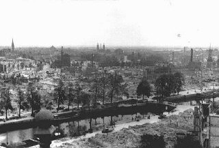 <p>Aerial view of the city of Rotterdam after it was bombed by the Luftwaffe (the German Air Force). Rotterdam, the Netherlands, May–June 1940.</p>