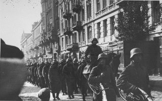 <p>German troops march into Paris. France, June 1940.</p>