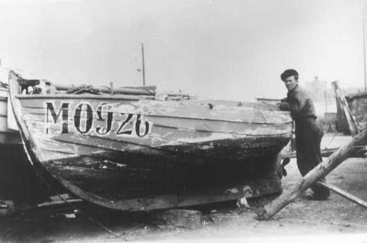 """<p>Danish fishermen used this boat to carry Jews to safety in Sweden during the German occupation. <a href=""""/narrative/4236/en"""">Denmark</a>, 1943 or 1944.</p>"""