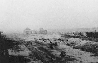 "<p>View after the obliteration of the <a href=""/narrative/3769/en"">Belzec</a> killing center showing a railway shed where victims' belongings were stored. Belzec, Poland, 1944.</p>"