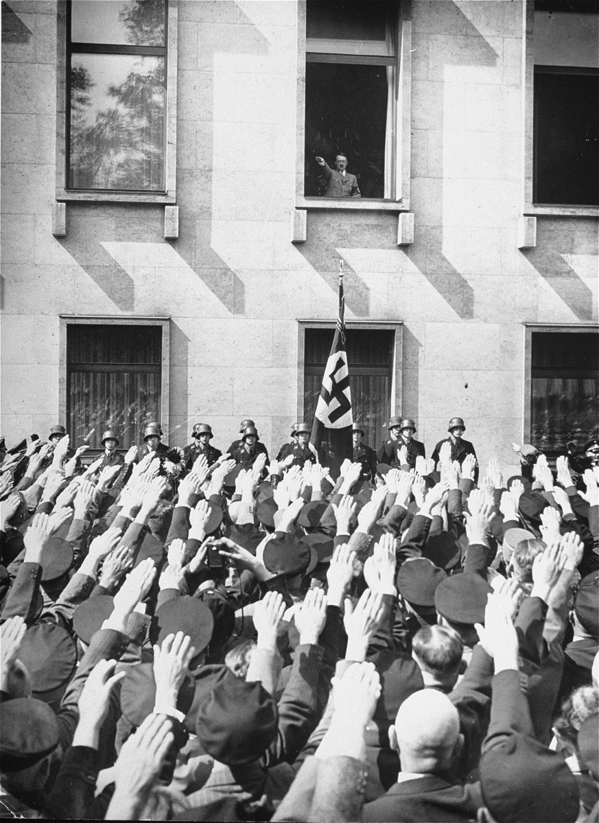 On the day of his appointment as German chancellor, Adolf Hitler greets a crowd of enthusiastic Germans from a window in the Chancellery building.