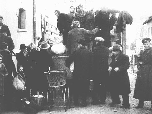 """<p>Bulgarian authorities round up Jews in occupied Macedonia for deportation. They were first held in a camp in Skopje and then deported to the <a href=""""/narrative/3819/en"""">Treblinka</a> killing center in German-occupied Poland. Skopje, Yugoslavia, March 1943.</p>"""