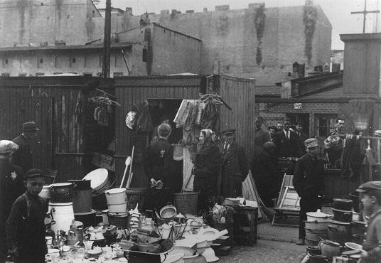 Scene in the Lodz ghetto marketplace. Jakubowicz's model of the Lodz ghetto recreates, on a small scale, the physical appearance of the ghetto, creating the shape of the model to mimic the exact boundaries, streets, and buildings that had a major impact on daily life in the ghetto.