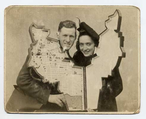 Leon Jakubowicz and his wife Rachela holding the model of the Lodz ghetto that Leon created.