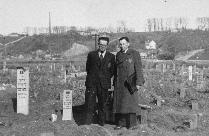 Secretary of the Kovno ghetto Jewich council Avraham Tory stands with Zvi Brik (left), workshop administrator, in the cemetery of the Kovno ghetto.