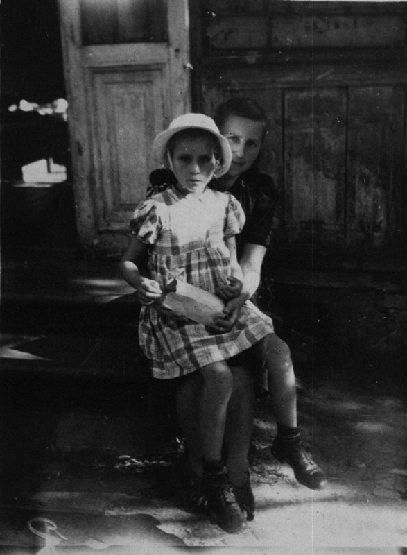 "<p>During a roundup for deportation in eastern Poland in 1942, Gitta Rosenzweig—then three or four years old—was sent into <a href=""/narrative/7711/en"">hiding</a>. She ended up in a Catholic orphanage. In 1946, Ida Rosenshtein, a family friend and a survivor, learned of the child's whereabouts and sought to claim her. After denying that it held a Jewish child, the orphanage relinquished <a href=""/narrative/7722/en"">custody</a> after Ida recognized Gitta and a local Jewish committee paid a ""redemption"" fee. Gitta is pictured here on the day she left the orphanage.</p>"