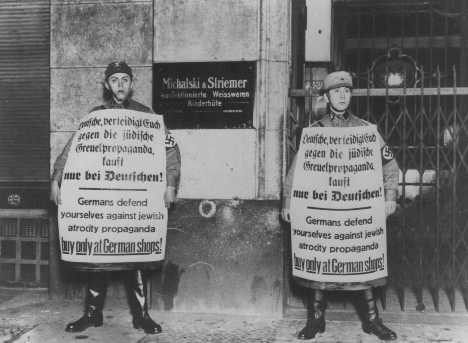 <p>SA men picket Jewish-owned business during the boycott. Berlin, Germany, April 1, 1933.</p>