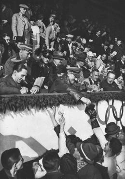 Adolf Hitler and Joseph Goebbels sign autographs for members of the Canadian figure skating team at the Winter Olympic Games. [LCID: 02322]