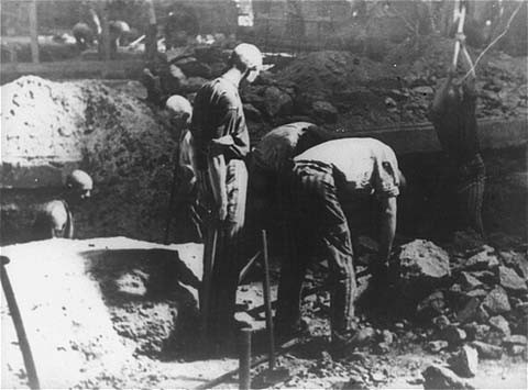 <p>Prisoners at forced labor break stone with pickaxes in the quarry of the Flossenbürg concentration camp. Flossenbürg, Germany, date uncertain.</p>